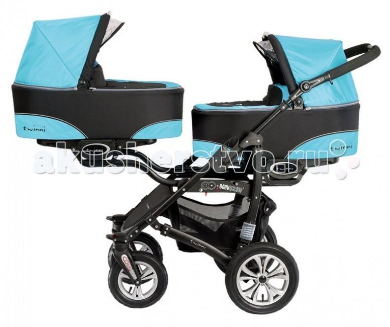 BabyActive Коляска для двойни Twinny 2 в 1Коляска для двойни Twinny 2 в 1Babyactive Twinny - всесезонная коляска, предназначенная для двух детей с рождения.  Основные характеристики: люльки и сиденья можно устанавливать как по ходу движения, так и против хода движения коляски сиденья оборудованы пятиточечными ремнями безопасности удобная ручка, регулируется по высоте большие колеса - залог хорошей проходимости по любым дорогам все колеса надувные для удобства транспорировки и мытья все колеса можно снять передние поворотные колеса придают коляске маневренность, при необходимости их можно зафиксировать в положении «только прямо» в основании рамы размещена большая корзина для детских игрушек или покупок  Особенности: Прочное металлическое шасси установлено на 2 пары колес, одна из которых поворотная с возможность блокировки для прямолинейного хода. Колеса надувные, съемные. Люльки и прогулочные сидения можно устанавливать по ходу и против хода движения коляски, или же одновременно 1 по ходу, второе - против хода движения - выбор за родителями. Люльки можно переносить. Каждое сидение коляски BabyActive Twinny оборудовано 5-точечными ремнями безопасности, так что ваш непоседа надежно зафиксирован. Спинка прогулочного блока регулируется по степени наклона. В сложенном виде коляска достаточно компактна. Коляска характеризуется высокой проходимостью, маневренностью и устойчивостью одновременно. У основания коляски есть удобная корзина для покупок. Широкий набор аксессуаров позволяет сделать эксплуатацию коляски простой и очень удобной процедурой. В комплекте 2 дождевика и 2 москитные сетки. Количество колес: 4, передние и задние одинарные Ширина шасси: 64 см Различная ширина передней и задней осей: да Колеса: съемные Корзина для покупок: есть, сетчатая Аксессуары: солнцезащитный козырек, сумка Размеры в разложенном виде с люльками (ВхШхД): 155х64х83 см Размеры в разложенном виде без люльки (ВхШхД): 123х64х83 см Размеры люльки (ШхД): 35х78 см Размеры сиденья (ШхД): 36х86 см