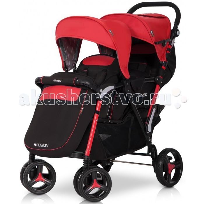 EasyGo Прогулочная коляска для двойни Fusion DuoПрогулочная коляска для двойни Fusion DuoДетская коляска EasyGo Fusion Duo станет незаменимой во время прогулок с двумя детьми.  Характеристики: Современная детская коляска предназначена для близнецов и детей разного возраста погодок Передний блок предназначен для детей в возрасте от 6 месяцев и до 15 кг веса Заднее сиденье предназначено для детей от рождения и до 15 кг веса Регулируемая подножка на переднем сиденье + дополнительная пластиковая 3 позиции регулировки спинки на заднем сидении Защитный барьер на переднем сиденье 2 капюшона с регулируемым козырьком 2 чехла для ног Регулируемая по высоте ручка Поворотные передние колеса с возможностью блокировки для движения по прямой Смотровое окошко и карман для мелочей в заднем блоке Очень большая корзина для покупок Дождевик с вентиляционными отверстиями EasyGO Fusion произведена в соответствии с европейским стандартом безопасности EN 1888: 2012  Размеры: В разложенном виде: 108х58х110 см В сложенном виде: 97х58х44 см Ширина сиденья: переднее и заднее 34 см Высота спинки: переднее и заднее 40 см Глубина сиденья: переднее 19 см, заднее 17 см Длина подножки (спереди): 15 см Диаметр колес: передние 19 см, заднее 23 см Вес: 13 кг.<br>