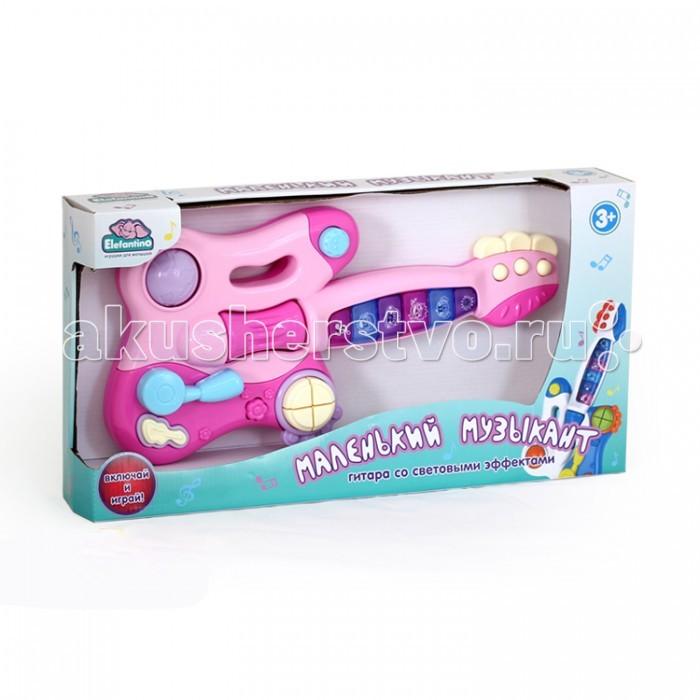 Музыкальная игрушка Elefantino Гитара Маленький музыкант на батарейкахГитара Маленький музыкант на батарейкахElefantino Гитара Маленький музыкант на батарейках IT10122  Прекрасная гитара Маленький музыкант предназначена специально для малышей. Музыкальный инструмент оснащен звуковым модулем, который воспроизводит зажигательные мелодии, под которым малыш может даже потанцевать. Также гитара имеет возможность обработки. Для особой эффектности выхода маленького гитариста в игрушечный инструмент встроены и световые модули.<br>