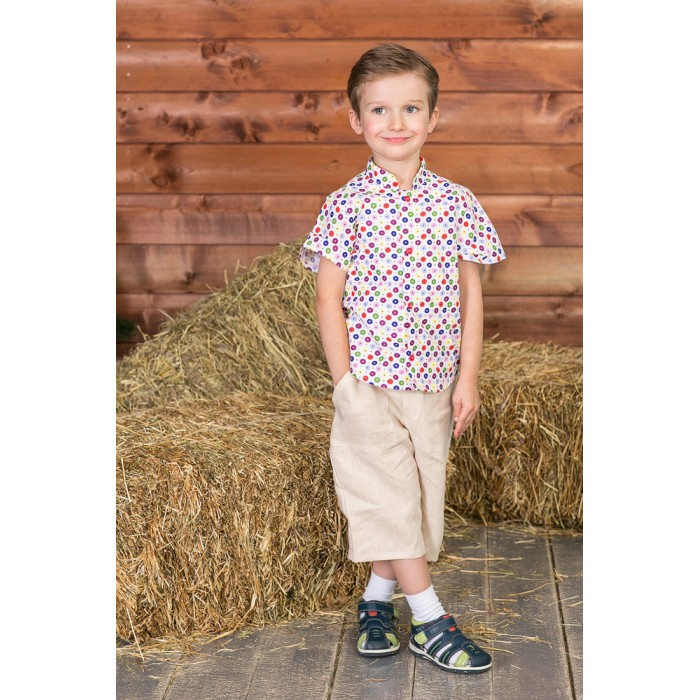 Frizzzy Рубашка детская Калейдоскоп пуговицРубашка детская Калейдоскоп пуговицFrizzzy Рубашка детская Калейдоскоп пуговиц  Рубашка детская из натурального материала - 100% хлопок. Рубашка гигроскопична, для длительной носки в течение дня.   Фасон рубашки - рукава с широкой проймой, учитывают подвижность ребенка.  Прекрасно сочетается с бриджами,  брюками,  комбинезонами Frizzzy.   Стирать рубашку рекомендуется при температуре до 40 градусов, в режиме деликатной стирки.<br>