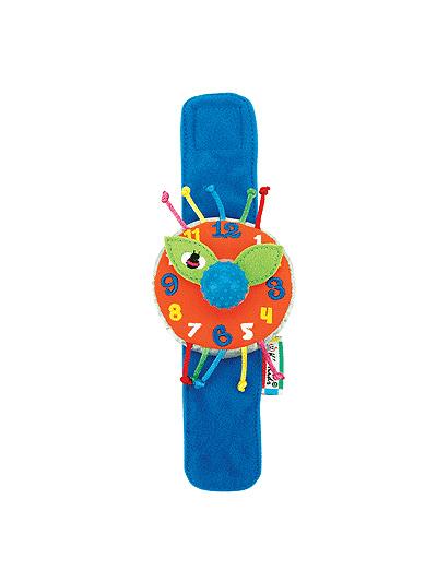 Развивающая игрушка KS Kids Мои первые часыМои первые часыЧасики мягкие наручные Мои первые часы KS Kids. С 3-х месяцев  ребенок начинает изучать свои ручки, именно в этом возрасте рекомендуют детям одевать разноцветные браслетики или часики.   Часики сделаны из мягкого материала. Их легко закрепить на ручке малыша при помощи мягкого широкого ремешка на липучке. Из большого круглого и мягкого циферблата торчат цветные шнурочки с узелками на концах - их можно перебирать пальчиками или дергать их.На циферблате вышиты цифры от 1 до 12 - ребенок со временем научится счету.   Плотные тканевые стрелочки можно покрутить, они крутятся независимо друг от друга; а можно покрутить их вместе – за большую рукоятку посередине. Она сделана из плотной пупырчатой резины. Если ее поворачивать - будет раздаваться треск. Различные ткани и текстуры поверхностей развивают тактильные ощущения ребенка.   Яркие цвета часов способствуют развитию зрения. Игра с часиками вырабатывает ловкость рук, сноровку и координацию движений, развивает мелкую моторику пальцев рук, а также стимулирует развитие умственных способностей.<br>