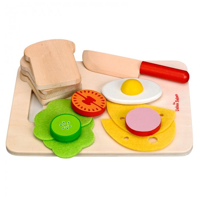 Spiegelburg Игровой набор для завтрака Die Lieben SiebenИгровой набор для завтрака Die Lieben SiebenSpiegelburg Игровой набор для завтрака Die Lieben Sieben.  Завтрак готов! - с таким призывом Ваш малыш будет играть с набором Die Lieben Sieben. Набор состоит из: разделочной доски, ножа, четырех ломтиков хлеба, двух листьев салата, четырех кусочков сыра, кусочка помидора, огурчика, колбаски и одно жареное яйцо. замечательный набор для маленьких кулинаров!<br>