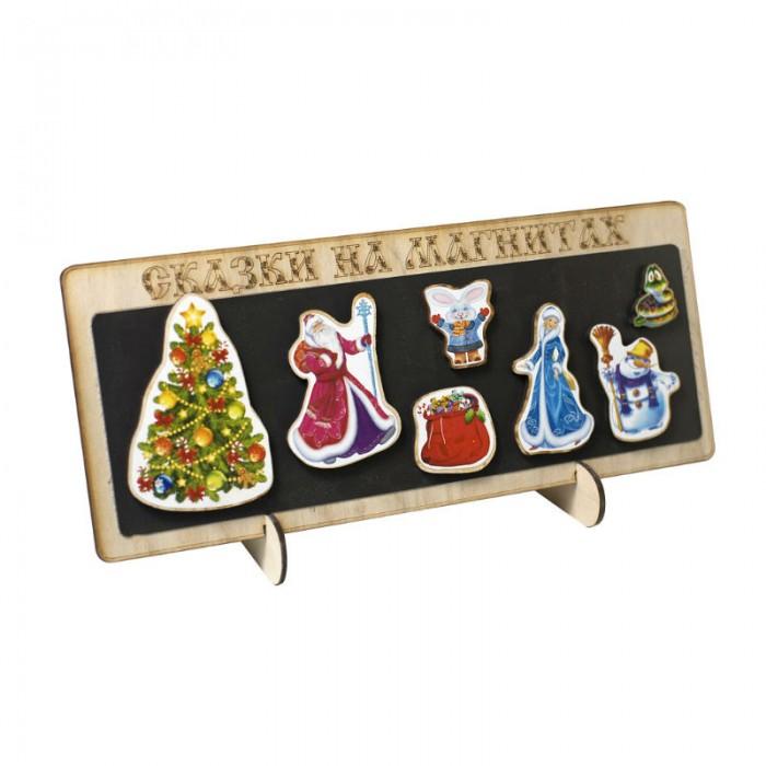 Бэмби Сказки на магнитах НовогодняяСказки на магнитах НовогодняяСказки на магнитах Новогодняя  Фигурки сделаны из тонкой фанеры, на которую наклеен яркий рисунок. Основание- магнит гибкий виниловый. Играть можно на любых металлических поверхностях: холодильнике, детском мольберте, или на входящем в набор планшете, размером 29х22 см.Можно разыграть сказку, построить героев по росту или придумать свою историю с этими героями.  Возраст: от 3 лет<br>