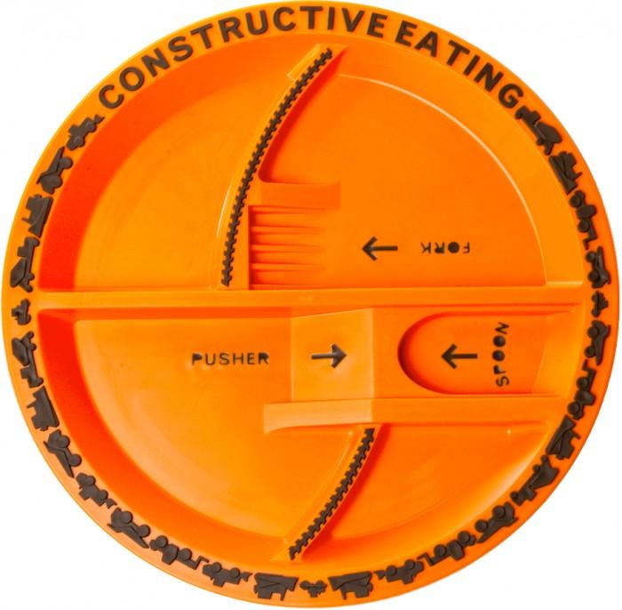 Constructive eating Construction Plate Тарелка Строительная серияConstruction Plate Тарелка Строительная серияНабор из трех столовых приборов Строительная серия.   Зонированая тарелка американского бренда Constructive Eating, занимающегося созданием развивающей посуды для детей.   Входит в «Строительную серию», разработанную специально для мальчиков. Уменьшенные образцы строительной техники, использованные для украшения кромки тарелки, являются резными, НЕ ОТДЕЛЯЮТСЯ и НЕ СНИМАЮТСЯ, ребенок их не проглотит.   Производится в США из качественных материалов, одобренных Управлением по санитарному надзору за качеством пищевых продуктов и медикаментов США. Может использоваться в микроволновке и посудомоечной машине.  Диаметр: 25 см<br>