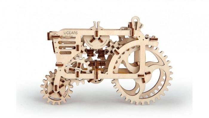 Конструктор Ugears 3D-Пазл Трактор 97 деталей3D-Пазл Трактор 97 деталейКонструктор 3D-Пазл Ugears Трактор  – это деревянный механический конструктор, собрав который вы получите самостоятельно движущуюся модель. Трактор имеет полный привод, то есть крутящий момент подаётся и на переднюю, и на заднюю оси. Модель сможет преодолевать небольшие препятствия и двигаться по пересечённой местности.  Под капотом – полноценный резиномотор с трёхступенчатой коробкой передач. Дизайнеры автогиганта Ugears создали абсолютно прозрачное покрытие, которое позволит непосредственно наблюдать за работой двигателя и каждого поршня. Передача «Park» служит для «заправки» резиномотора: чтобы завести его, покрутите заднее колесо. На передаче «Drive» модель поедет довольно неторопливо (около 5 см/с), а для любителей скорости есть передача «Sport».  Дизайн Игрушка имеет классический абрис трактора с открытой кабиной. Боковые стенки тоже открыты – чтобы можно было видеть, чем живёт внутренняя машинерия. В виде шестерёнок, основного мотива серии, выполнены даже колеса. Вы не найдёте в этой модели острых углов: он будто собран из дуг и окружностей, и его прямые плавно переходят друг в друга даже во внутренних вырезах.  Набор изготовлен из фанеры при помощи программируемого лазерного станка: детали легко выдавливаются из планшетов, заусенцев практически не образуется, все надписи (режимы движения, условные обозначения, логотип производителя) нанесены тоже при помощи лазера. По качеству эти модели намного превосходят изготовленные штампованием.  Как это работает? Для сборки этой модели достаточно выдавить готовые детали и собрать их, следуя инструкции. Крепление производится посредством специальных гнёзд и пазов. Также понадобится несколько обыкновенных зубочисток и канцелярская резинка для мотора. В Тракторе много подвижных сочленений, и важно, чтобы каждое работало как часы. Оси скрипящих шестерёнок и заедающие зубчики можно смазать парафиновой или восковой свечкой.  Заводить мотор нужно, поворач