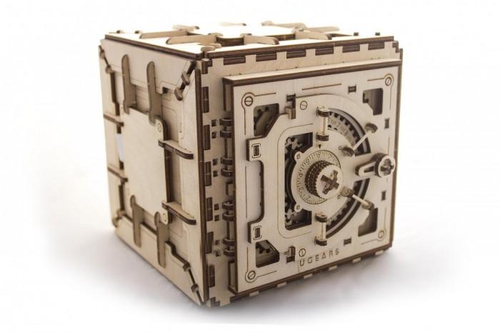 Конструктор Ugears 3D-Пазл Сейф 179 деталей3D-Пазл Сейф 179 деталейКонструктор 3D-Пазл Ugears Сейф  Вы получите настоящий деревянный сейф с кодовым замком, вращающимся ручками и характерными щелчками, так что запаситесь стетоскопом и попробуйте открыть его, не подглядывая в код.  Как использовать сейф? Например, вовнутрь вы можете положить приз и предложить компании игру в медвежатников. Есть два варианта: попробовать открыть сейф, слушая звуки внутри, или крутить ручку наугад. Веселье гарантированно. Главное – предварительно потренироваться самому и объяснить друзьям принципы открытия замка.  Сейф от UGears – занимательный способ сохранить не только ценные вещи, но и теплые воспоминания.  Дизайн Набор изготовлен из фанеры при помощи программируемого лазерного станка: детали легко выдавливаются из планшетов, заусенцев практически не образуется, все надписи (режимы движения, условные обозначения, логотип производителя) нанесены тоже при помощи лазера. По качеству эти модели намного превосходят изготовленные штампованием.  Как это работает? Сначала обнулите кодовый замок: покрутите ручку сейфа против часовой (влево) на один-два оборота.  Теперь можно набирать код: Проверните ручку против часовой (влево) до первой цифры от 1 до 9. Остановитесь на ней. Теперь крутите ручку по часовой (вправо) до цифры ноль. После прохождения нуля продолжайте крутить ручку вправо до второй цифры кода от 1 до 9. Остановитесь на ней. Снова крутите ручку против часовой (влево) до третьей цифры кода.  Характеристики Материал фанера (ФК) Размеры модели 196 &#215; 185 &#215; 176 мм Размеры внутренней камеры 155 &#215; 140 &#215; 105 мм   Что в коробке Набор планшетов с деталями для сборки 3D-пазла Сейф Документация (RU, UA, EN)<br>