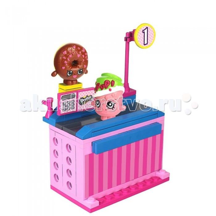 Конструктор Shopkins Магазин Пончик Д'лиш и Сода Попс 62 деталиМагазин Пончик Д'лиш и Сода Попс 62 деталиShopkins Конструктор Магазин Пончик Д'лиш и Сода Попс из серии Shopkins Kinstructions может быть совмещен с элементами Lego. Теперь можно построить все, что угодно!  В набор входят 62 детали, среди которых все необходимые элементы для построения кассы и кассовой ленты, а также две разборных фигурки: Пончик Д'лиш и Сода Попс. Каждая фигурка состоит из трех частей.<br>