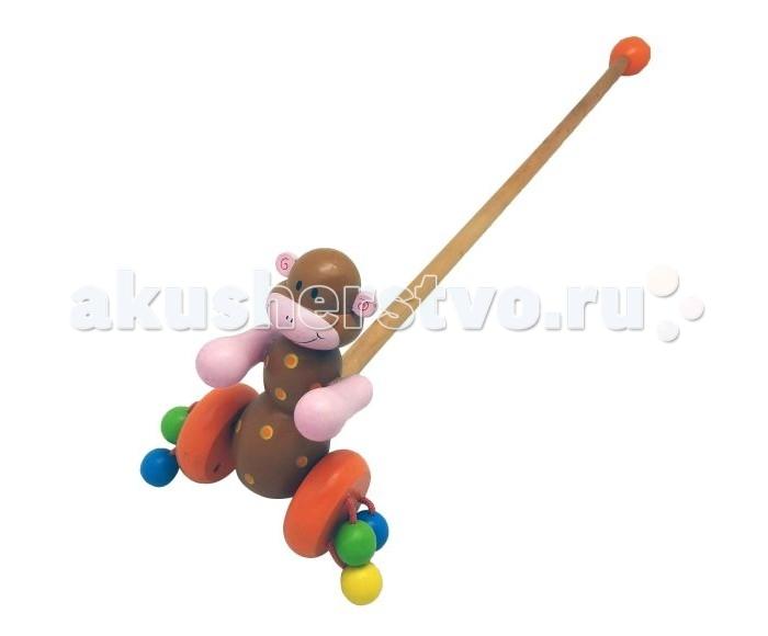 Каталка-игрушка Mapacha МартышкаМартышкаКаталка-игрушка Mapacha Мартышка с колечком обязательно понравится малышу!   Особенности: Она привлечет внимание своей яркой расцветкой и забавной игрушкой в виде пчелки.  К колесикам каталки приделаны разноцветные деревянные шарики, которые гремят во время движения.  Ручку-держатель можно открутить и играть только с игрушкой на колесиках.  В целях безопасности ручка снабжена круглым набалдашником. Игрушка-каталка способствуют физическому развитию малыша - помогает сделать первые шаги и освоить навыки ходьбы.  Развивает координацию движений и способность ориентироваться в пространстве. Игрушка изготовлена из натурального дерева.<br>