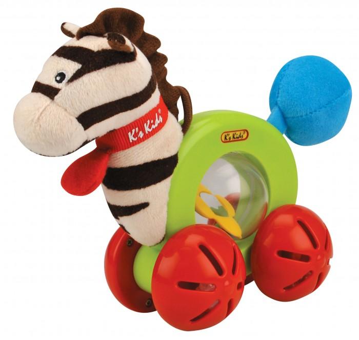 Погремушка KS Kids Райн на роликахРайн на роликахРазвивающая игрушка Райн на роликах Ks Kids.  Забавная зебра Райн побуждает малыша ползать и ходить. Благодаря ножкам-роликам игрушка может быстро ехать, при этом привлекая внимание малыша подвижными шариками.  Прозрачные шарики находятся в ножках-роликах, а разноцветные в прозрачном шаре-животике зебры, соседствуя с маленьким зеркалом в форме цветочка.  В «хвостике» Райна находится пищалка. Маленькая петелька, находящаяся на голове зебры, позволяет подвесить игрушку на развивающие коврик или дугу.  Размер игрушки: 7х19х15,5см<br>
