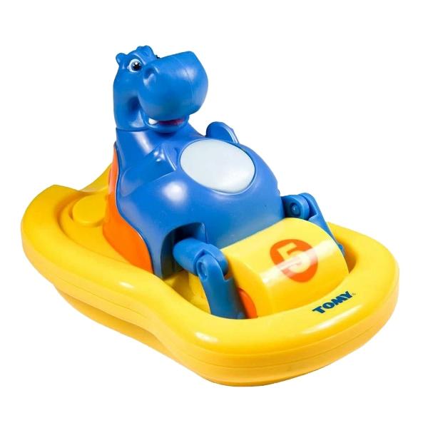 Tomy Игрушка для купания БегемотикИгрушка для купания БегемотикМузыкальный Бегемотик от Английского бренда Tomy превратит купание малыша в увлекательную игру. Он катается на водном велосипеде, поёт песенку и пускает пузыри.  Особенности:   У игрушки нет выступающих движущихся механизмов и острых углов;   Если нажать на кнопочку на животике Бегемотика, то он поплывет на своем катамаране, крутя педали и напевая веселый мотивчик;   Можно выбрать направление движения водного транспорта – прямо, направо или налево;   Для воздушных и радужных пузырей, которые появятся при движении катамарана, нужно просто налить пену для ванной в специальное углубление сзади велосипеда;  В процессе игры развивается координация и слаженность движений рук, пространственное представление.<br>