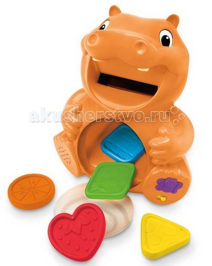 Playskool Hasbro Обучающая игрушка БегемотикHasbro Обучающая игрушка БегемотикИгрушка развивающая - «Бегемотик» Playskool A3208H.  Благодаря такому милому бегемотику, малыш сможет научиться читать на английском языке. Но просто так бегемотик ничего не будет делать, вначале малыш должен накормить его спелыми, сладкими и сочными фруктами, которые предусмотрены в наборе.   В наборе находятся фигурки разной формы и цветов, которые выполнены из безопасного пластика. Когда бегемот съест фрукт, то он назовёт его цвет и форму.   Бегемотик во время игры может говорить на английском и русском языках.   Для работы игрушки необходимо наличие 3 батареек типа АА, которые входят в набор.<br>