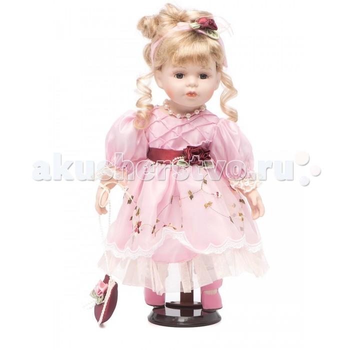Angel Collection Кукла фарфоровая Жюли 14 35.6 смКукла фарфоровая Жюли 14 35.6 смКаждая кукла, выпущенная в серии Angel Collection, обладает неповторимым образом - принцессы, феи, маленькие девочки, роскошные невесты и т.д. Изысканные наряды и очаровательная матовость фарфора превращают этих кукол в настоящее произведение искусства.   Куклы сделаны из уникальной голубой глины.  Фарфоровая красавица - это не просто игрушка, а также украшение для интерьера или ценный экспонат коллекции.  Высота куклы: 35.6 см<br>