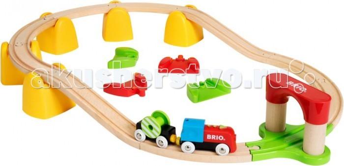 Brio Игровой набор Моя первая железная дорогаИгровой набор Моя первая железная дорогаИгровой набор Мая первая железная дорого от бренда Brio включает в себя деревянные элементы, которые помогут собрать паровозик, рельсы и тоннель. Поезд способен самостоятельно двигаться по рельсам. На последнем вагончике расположен груз в виде катушки, которые крутится при движении паровозика. Вагоны поезда сцепляются с помощью магнитов, поэтому из можно легко разъединить, если это необходимо.  В комплекте:   1 паровоз; 1 вагон; Детали для сборки железной дороги; Аксессуары.  Основные характеристики:   Размер упаковки: 45 х 27 х 12 см Размер площадки: 70 х 48 см<br>
