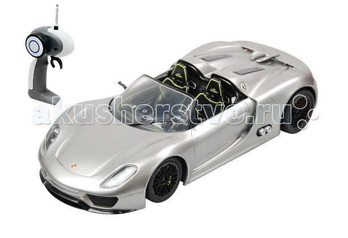 Auldey Машина на батарейках радиуоправляемая Porsche 918 Spyder Concept LC258110Машина на батарейках радиуоправляемая Porsche 918 Spyder Concept LC258110Porsche 918 Spyder Concept  - Этот радиоуправляемый автомобиль доставит вашему ребенку массу незабываемых впечатлений от динамичной, захватывающей игры.  Автомобиль оснащен по последнему слову игрушечной техники: он имеет профессиональное шасси, полнофункциональный радиоконтроль, свет передних и задних фар, независимую подвеску передних и задних колес, что позволяет ему имитировать маневры настоящей машины.  Радиус действия пульта — не менее 15 м. Скорость — 9 км/ч, в турборежиме — 11 км/ч.  Питание: 2 батарейки типа АА для пульта управления, 4 батарейки типа АА для машинки.<br>
