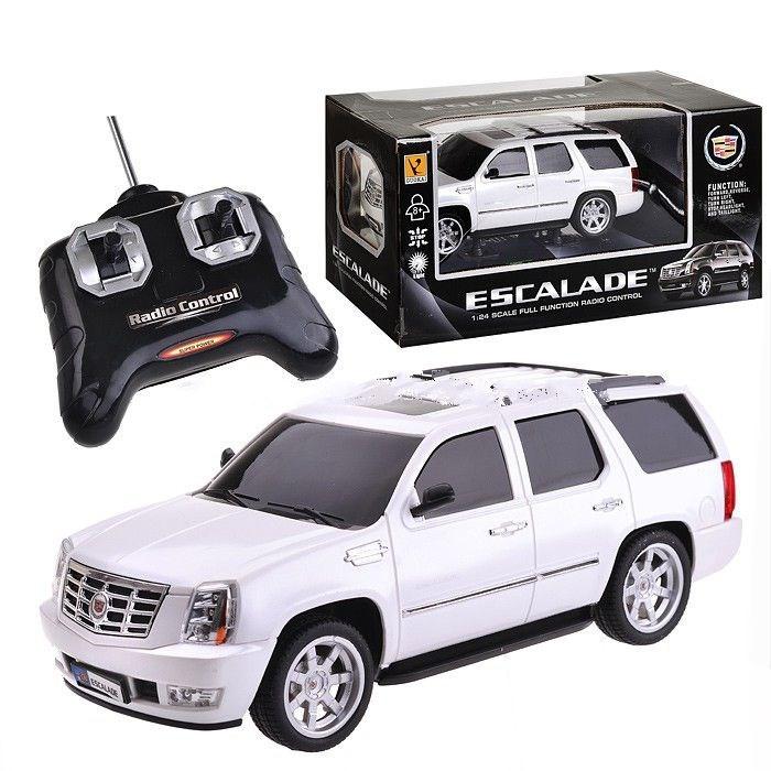 GK Racer Series Машина р/у Cadillac Esclade 1:24 на батарейкахRacer Series Машина р/у Cadillac Esclade 1:24 на батарейкахGK Racer Series Машина р/у Cadillac Esclade 1:24 на батарейках 866-2411  Радиоуправляемая машина «Escalade» - отличный выбор для юного поклонника автомобилей! Реалистичный дизайн. Полнофункциональное управление. Световые эффекты. Масштаб: 1:24. Машина работает от 3-х батареек 1,5V типа «АА» (в комплект не входят). Состоит из пластмассы. Соответствует требованиям безопасности и стандартам качества продукции. Для детей от 8 лет.<br>