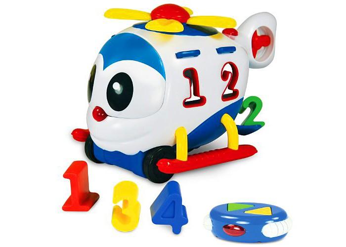 Развивающая игрушка Learning Journey Радиоуправляемый умный вертолетикРадиоуправляемый умный вертолетикLearning Journey Развивающая игрушка Радиоуправляемый умный вертолетик - это многофункциональное устройство на радиоуправлении, которое обязательно понравится вашему малышу. Игрушка разработана для детей от 1.5 годиков. Она обладает световыми и звуковыми эффектами. Вертолетик может работать в 3х режимах - как сортер, как развивающая и как радиоуправляемая игрушка. Малыш познакомится с цифрами и цветами, разовьет свои логические и моторные навыки. Вертолетик издает забавные звуки и проигрывает веселые мелодии, его колесики вращаются, а милый носик загорается.  Возраст: от 18 месяцев Комплект: вертолетик, пульт д/у, 4 разноцветных формочки. Наличие батареек: входят в комплект. Тип батареек: 2 x AA / LR6 1.5V (пальчиковые). Эффекты: свет, звук.<br>