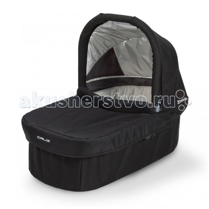 Люлька UPPAbaby для коляски Cruzдля коляски CruzЛюлька UPPAbaby для коляски Cruz подходит для детей с рождения до 6 месяцев. Обеспечивает тепло и комфорт самым маленьким пассажирам. Ручки предназначены для удобной транспортировки из коляски, не беспокоя ребенка. Быстрое и удобное крепление к коляске. Козырёк UPF50 от солнца съёмный.  Максимально допустимый вес ребенка: 9 кг Максимальный рост ребенка: 63 см Комплектация: люлька, съемный дышащий наматрасник<br>