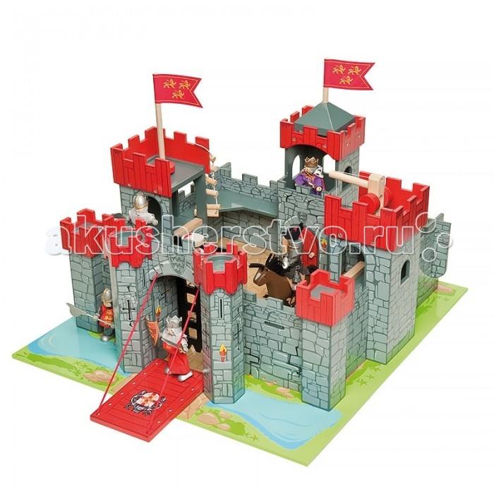 LeToyVan Набор Замок Львиное сердце, коврик и 3 фигурки рыцарейНабор Замок Львиное сердце, коврик и 3 фигурки рыцарейНабор Замок Львиное сердце, коврик и 3 фигурки рыцарей - превосходный подарок для любого мальчишки.  Набор включает в себя три взаимно дополняемых игрушки: Рыцарский замок для фигурок Львиное сердце  Игровой коврик Замок Кукла Ричард Львиное сердце  Кукла Железный рыцарь  Кукла Мальтийский рыцарь Рыцарский замок для фигурок Львиное сердце имеет 7 башен: смотровые, флаговые, тюремная; лебедку, 2 флага, лестницы - веревочную и приставную. Ворота открываются, образуя перекидной мост, за ними дополнительное укрепление - в виде решетки. Изображения гербов на внутренних и внешних стенах. Рядом с мостом есть потайная дверца для побега. Стены замка разукрашены под камень, внутренний двор так же замощен камнем. Вокруг замка изображен защитный ров с водой и трава. Замок легко собирается. Упакован в подарочную коробку с пластиковой ручкой.  Игровой коврик Замок выполнен из полиэстра высокого качества,  благодаря прорезиненной противоскользящей основе подходит для любых напольных покрытий. Превосходное качество нанесения рисунка, отличная детализация и четкость картинки, уникальный дизайн вдохновят любого ребенка на долгую игру. Коврик удобен для хранения (сворачивается рулоном).  Куклы выполнены из дерева. Ручки и ножки гнуться. Каждая игрушка имеет индивидуальную упаковку. Их можно использовать как самостоятельную игрушку или как набор.  Размер замка: 56х60х45 см Размер коврика: 150 х 100 см Размер куклы: 10 см<br>