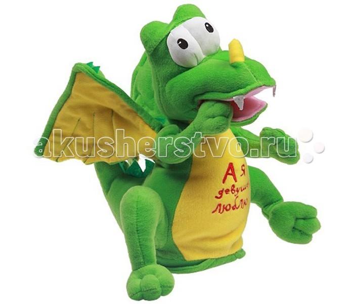 Интерактивная игрушка Ваш подарок Поющий Дракончик Кузьма КузьмичПоющий Дракончик Кузьма КузьмичВаш подарок Интерактивная игрушка Поющий Дракончик Кузьма Кузьмич  Дети просто обожают игрушки, особенно необычные! Если новая игрушка станет не только надежным партнером для веселых игр, но еще и сможет спеть песенку или станцевать, восторгу ребенка не будет предела! А некоторые игрушки смогут порадовать даже взрослых людей. Поющая игрушка Дракончик Кузьма Кузьмич больше подойдет в качестве подарка для взрослого человека. Задорный дракончик настоящий ловелас – это подтверждает надпись «А я девушек люблю!» у него на груди. Кроме того, он еще и исполняет одноименную песню голосом известного артиста Олега Газманова. Кузьма не только поет, но еще и открывает рот в такт музыке и от полноты чувств машет крыльями.  Игрушка сделана из полиэстера, искусственного меха и пластика. Питанием служат 3 «пальчиковые» батарейки.<br>