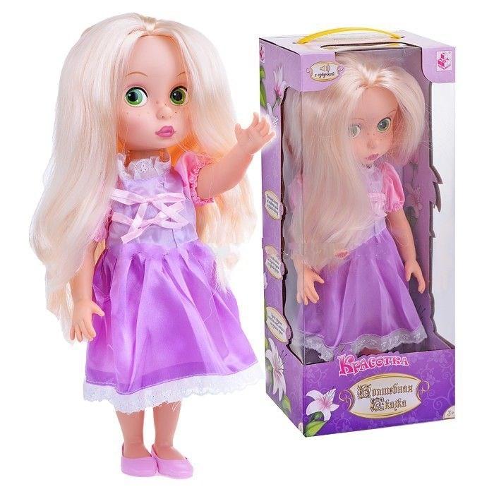 1 Toy Кукла Волшебная сказка Красотка Т58294 40 смКукла Волшебная сказка Красотка Т58294 40 см1 Toy Кукла Волшебная сказка Красотка 40 см обязательно понравится вашей малышке и займет ее внимание надолго.  Особенности: У куклы имеется встроенный звуковой модуль.  Игрушка озвучена профессиональным актерским голосом на русском языке.  Если нажать на ее правую ладонь, то можно услышать музыкальное приветствие. При повторном нажатии кукла произносит фразу: Раз, два, три, четыре, пять, я хочу с тобой играть!.  На груди у куколки имеется кнопка в форме сердца.  При нажатии на нее, можно услышать те же самые слова.  Еще очаровательная кукла споет веселую детскую песенку.  Внимание! Дизайн куклы незначительно варьируется и может отличаться от представленного на фото.<br>