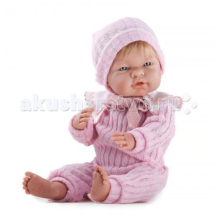 Dnenes/Carmen Gonzalez Кукла-пупс реборн Мио-Мио в розовом комбинезоне 48 смКукла-пупс реборн Мио-Мио в розовом комбинезоне 48 смКукла-пупс реборн Мио-Мио в розовом комбинезоне очень похожа на новорожденного ребёнка. Особое внимание производитель уделил мелким деталям - пухлые щечки, яркие глазки, складочки на ручках и ножках. У куклы очень комфортный размер. С ней приятно и удобно играть.  Малышка одета в розовый вязаный комбинезон из мягкой пряжи. У комбинезона длинные рукава и штанины, а так же застежка-липучка на спине. Широкий декоративный воротничок из плотной хлопчатобумажной ткани снимается. Он отделан тесьмой и имеет завязочки из трикотажа. В дополнение к комбинезону на голову куклы одета вязаная шапочка.  Волосы светлы, хорошо прошитые Глаза ярко-серо, стеклянные, без ресничек, не закрываются.  Ножки имеют форму близкую к анатомической.  Кукла не имеет запаха и обладает приятным тактильным эффектом.  Кукла Carmen Gonzalez продается в красивой подарочной коробке с прозрачным окошком.<br>