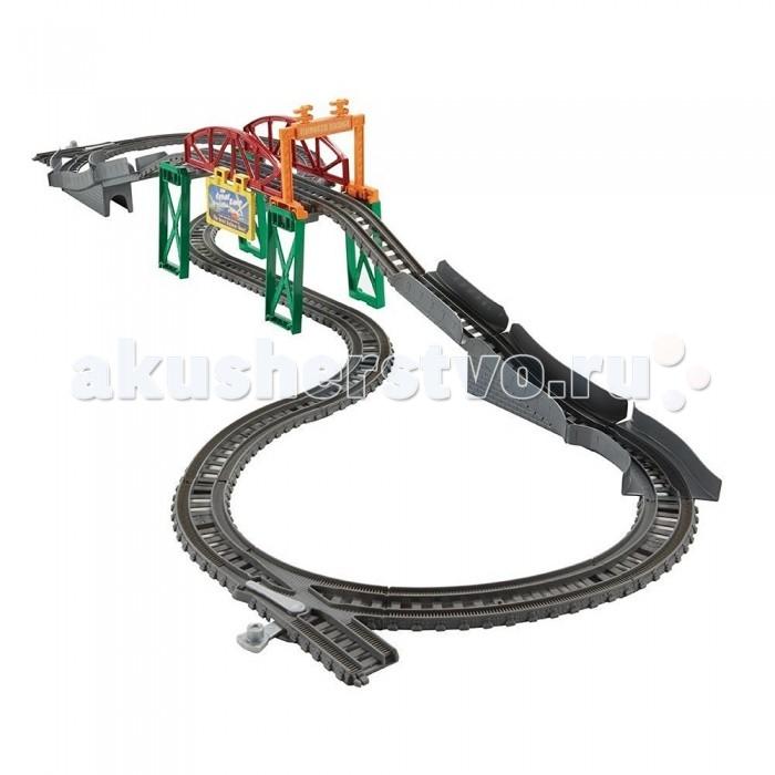 Thomas &amp; Friends Игровой набор 2 в 1 Мост ТидмутаИгровой набор 2 в 1 Мост ТидмутаИгровой набор 2 в 1 «Мост Тидмута» - это дополнение к набору железной дороги TrackMaster, которое делает игру более разнообразной.   Набор позволит составам ездить в новых направлениях. Мост состоит из отбойника, сигнального мостика и яркого знака «Большая гонка».   Железная дорога выполнена в сером цвете, а детали моста красного, зеленого, желтого и оранжевого цветов.   Все детали набора очень легко соединяются между собой. Ребенок легко справится сам с этой задачей.   Игровой набор включает в себя 25 элементов (отбойник, знак «Большая гонка», сигнальный мостик, элементы железной дороги).   Набор продается в красочной коробке из плотного картона.<br>
