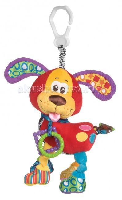 Подвесная игрушка Playgro Щенок 0181200Щенок 0181200Мягкая игрушка Щенок от фирмы Playgro, обязательно понравится вашему малышу. Игрушка имеет удобное колечко, чтобы можно было прикрепить ее к сидению, коляске или кроватке.   Внутри подвески имеется погремушка, которая весело озвучит игру ребенка с ней. Игрушка уже с первых дней покажет, насколько она полезна, ведь она поможет развить все чувства: моторику, зрительную координацию, слух, а также причинно-следственные связи. Все это возможно благодаря различным фактурам на лапках.<br>
