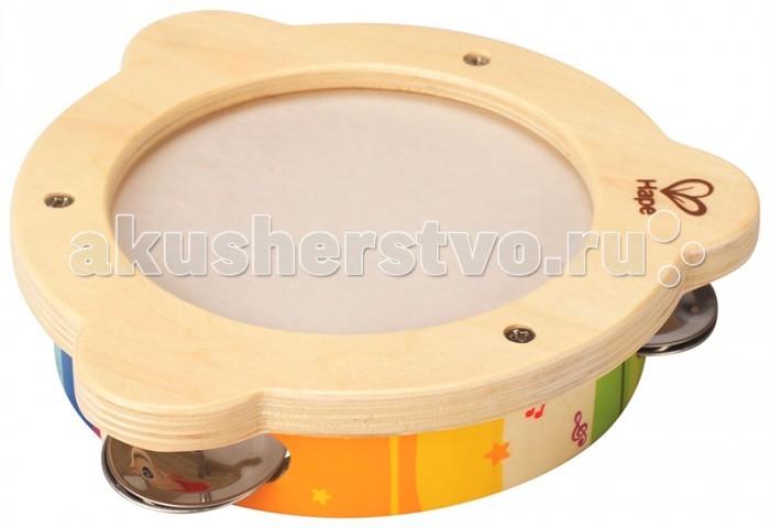 Деревянная игрушка Hape Бубен Е0304Бубен Е0304Удобный компактный бубен, он развлечет малыша во время игры и разовьет музыкальные навыки. Задорные звуки не дадут ребенку сидеть на месте, он не только сыграет, но и станцует под музыку. Игрушка развивает чувственное восприятие, зрительную координацию и моторику, а также учит основам ритма и музыки.  Рекомендована для детей от 12 месяцев.  Размер упаковки: 18 х 6 х 18 см Размер игрушки: 17,27 х 17,27 х 4 см<br>