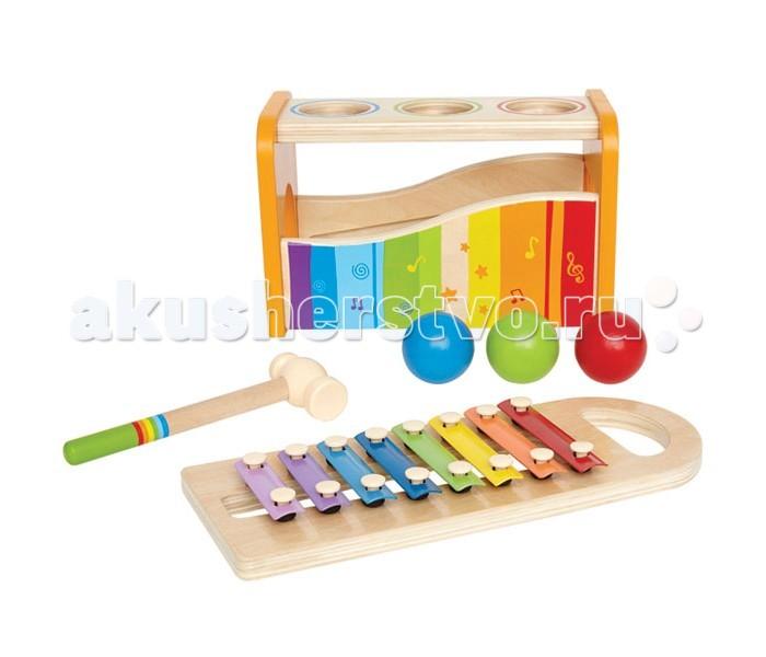 Музыкальная игрушка Hape Музыкальный набор Е0305Музыкальный набор Е0305В набор входит: деревянный каркас, 3 разноцветные деревянные шарика, ксилофон с металлическими клавишами, молоточек.  Играть можно двумя способами: бить молоточкам по шарикам, они будут падать внутрь и в сопровождении веселых звуков выкатываться из ворот; ксилофон можно использовать отдельно, для этого его необходимо вытащить из деревянного каркаса. Ксилофон с разноцветными клавишами воспроизводит целую октаву звуков. Игрушка развивает навыки мелкой моторики, координацию движений, учит пониманию причины и следствия.  Размер упаковки: 30 х 15 х 18 см Размер игрушки: 24 х 15 х 13.5 см<br>