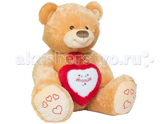 Мягкая игрушка Нижегородская игрушка Мишка большой с сердцем 80 смМишка большой с сердцем 80 смМишка большой с милым сердечком в мягких лапах непременно станет настоящим любимцем.   Веселый пушистый медвежонок с подвижными лапами изготовлен из высококачественного, гипоаллергенного искусственного меха и синтетического наполнителя, которые безопасны для здоровья ребенка.   Очаровательный мишка выглядит очень забавно и непременно поднимет настроение даже в самый грустный день. Его приятно держать в руках и даже спать с ним в одной кроватке.  Играя с медвежонком у ребенка формируются новые навыки, развиваются тактильные ощущения и фантазия.<br>