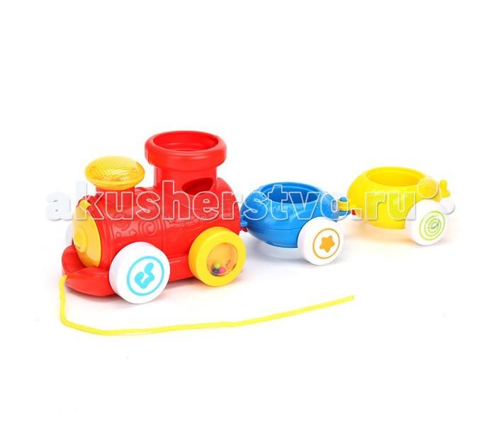 Умка Паровозик-пирамидкаПаровозик-пирамидкаМашина Умка Поаровозик-пирамидка со светом и звуком. Развивает слуховое и визуальное восприятие, чувство ритма и музыкальный слух.  Особенности: 3 песни из м/ф музыкальный сортер гремящие шарики световые эффекты игрушку можно катать батарейки входят в комплект<br>