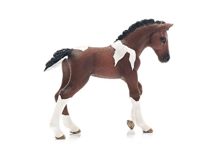 Schleich Игровая фигурка Тракененская лошадь жеребенокИгровая фигурка Тракененская лошадь жеребенокОчаровательная фигурка пятнистого жеребенка Тракененской лошади непременно понравится вашему ребенку и разнообразит его игру с лошадями Schleich Шляйх. Тракененская порода лошадей является чистокровной породой верховой лошади и является настоящим идеалом для современной спортивной езды. Они очень талантливы и легко поддаются дрессировке. Тракененская порода лошадей достигает в высоту 160 см и бывает самых разных расцветок.  Все фигурки Schleich сделаны из гипоаллергенных высокотехнологичных материалов, раскрашены вручную и не вызывают аллергии у ребенка.  Прекрасно выполненные фигурки Шляйх отличаются высочайшим качеством игрушек ручной работы. Все они создаются при постоянном сотрудничестве с Берлинским зоопарком, а потому, являются максимально точной копией настоящих животных. Каждая фигурка разработана с учетом исследований в области педагогики и производится как настоящее произведение для маленьких детских ручек.  Основные характеристики:  Размер фигурки: 2,5 x 8,9 x 7,1 см Вес: 41 г<br>