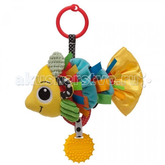 Подвесная игрушка Infantino РыбкаРыбкаДружелюбная яркая и красочная рыбка начнет вибрировать, если потянуть за нее, и это, несомненно, привлечет внимание малыша, а приятный звук погремушки поможет развить его звуковое восприятие.  Рыбка выполнена из материалов с различной текстурой для стимулирования тактильных ощущений и цветового восприятия. Ребенок будет держать рыбку за атласные ленточки, шуршащий хвостик и другие детали рыбки, кусать прорезыватель, развивая тем самым тактильные ощущения.     Для стимулирования цветового восприятия, чешуйки рыбки выполнены в виде мягких оборочек. С одной стороны в черно-белой гамме (в первые месяцы новорожденные еще не могут различать другие цвета), с другой стороны, для стимулирования раннего развития ребенка, использованы яркие контрастные цвета: желтый, красный, синий, зеленый.  Прикрепите игрушку на детском автокресле, коляске и дугах игрового коврика или просто дайте малышу в руки.  Размеры: 13,3 х 9,7 см   Игрушка полностью безопасна, не содержит бисфенол-А и поливинилхлорид.<br>