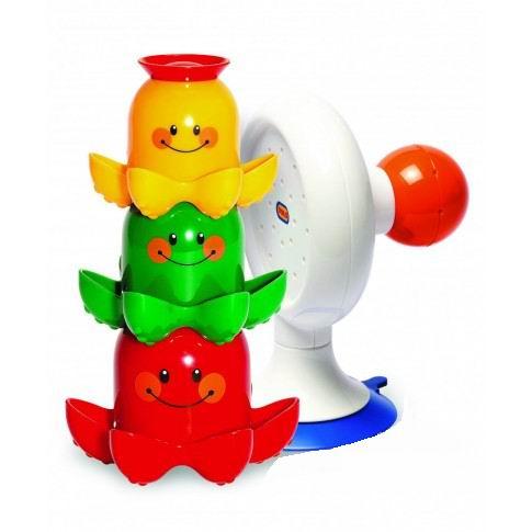 Tolo Toys Водопад ОсьминожкиВодопад ОсьминожкиВ этом замечательном наборе для игры в ванной малыша будут развлекать три разноцветных осьминога: красный, желтый и зеленый.  Все осьминожки разного размера: красный - самый большой, зеленый - средний, а желтый - самый маленький.  Малыш сможет складывать осьмоножек друг в друга или сделать из них пирамидку, что поможет ребенку в развитии логики.  На голове у каждого из них оригинальная разноцветная шляпка с отверстиями различной формы. Набирая в осьминога водичку, малыш сможет наблюдать как она вытекает через шляпку.  Идеальная игрушка для ванной, пляжа или сада. Присоска надежно закрепляет игрушку на стенке ванны.   Игрушки Tolo отличаются высоким качеством изготовления и повышенной прочностью.<br>