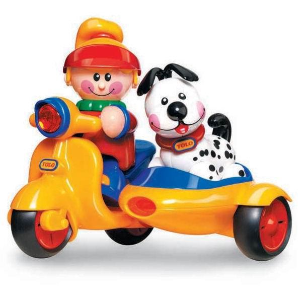 Развивающая игрушка Tolo Toys Мопед с коляскойМопед с коляскойЗамечательный мотоцикл с коляской.   В набор входят фигурка девочки и щенок.  Поощряет взаимодействие и развивает фантазию.  Игрушки Tolo отличаются высоким качеством изготовления и повышенной прочностью.<br>
