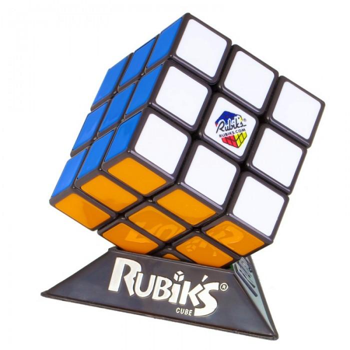 Рубикс Кубик Рубика 3х3 без наклеек, мягкий механизмКубик Рубика 3х3 без наклеек, мягкий механизмКубика Рубика 3х3 - самый совершенный, самый узнаваемый, самый желанный, самый сложный и самый интересный кубик. Это идеальное воплощение головоломки, флагман своей категории, соединяющая увлекательную игру и интеллектуальное развитие.  Особенности кубика Рубика 3х3: Улучшенный механизм с хрустом, новый кубик Рубика крутится плавнее, мягче и при этом точнее Высококачественный пластик (литье) Цветные пластиковые вставки вместо наклеек - сколько бы вы ни крутили головоломку, ваш кубик Рубика всегда в идеальном состоянии, как новый! Новая упаковка-пирамида с 3 крыльями, подчеркивающая новый характер игрушки Фирменная подставка для удобного хранения игрушки Единственный настоящий кубик Рубика, сделанный по венгерской лицензии Эрно Рубика Сертификаты качества – CE (европейский) Отлично подходит для подарка  Размеры: 5,7 х 5,7 х 5,7 см. Материал: пластик.<br>