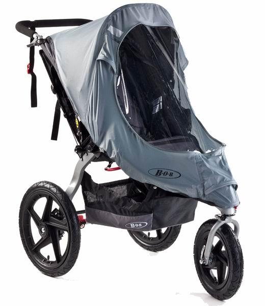 Дождевик BOB для колясок с поворотным колесомдля колясок с поворотным колесомДождевик для коляски BOB из высококачественного и прочного материала надежно защитит от влаги, при этом сохранив обзор.  Он быстро и удобно крепится к коляске, защищая от непогоды.<br>
