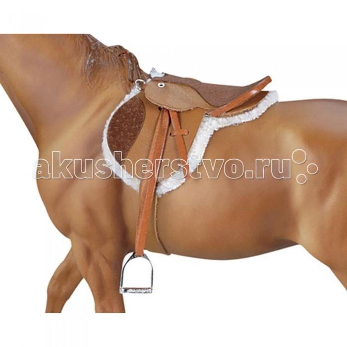 Breyer Седло и вальтрап для охоты и прыжковСедло и вальтрап для охоты и прыжковСедло из натуральной кожи коричневого цвета, используемое для выездки, отличается длинными крыльями и глубоким сиденьем. Предназначено для лошадей серии Traditional.   Седло должно гарантировать всаднику удобную посадку и одновременно хорошо соответствовать спине лошади. Седло используется в классических видах конного спорта (троеборье, конкур, выездка), а также для охоты.  В набор входит: Седло Стеганный вальтрап   Все изготовлено из высококачественных материалов, экологично и абсолютно безопасно.    Рекомендовано детям от 4 лет.<br>