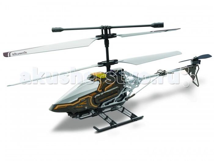 Silverlit Вертолет Скай Ай с камерой 3х канальный. Он-лайн трансляция изображенияВертолет Скай Ай с камерой 3х канальный. Он-лайн трансляция изображенияВертолет Скай Ай с камерой 3х канальный.  Он-лайн трансляция изображения на пульт д/у  В широком ассортименте изделий от производителя Silverlit есть разнообразные модели с дистанционным управлением по радиоканалу.  Вертолет Скай Ай является одной из самых совершенных игрушек соответствующей серии.  Вертолеты на р/у Silverlit создны очень грамотно, с должным вниманием к мелким деталям.  Даже при внимательном изучении этой техники у требовательного пользователя не возникнет ни малейших претензий.  Симпатичный внешний вид вертолета Скай Ай сразу же привлекает внимание, но ведь в данном случае особо важен его функционал.  Качественно созданная, хорошо сбалансированная конструкция упрощает управление данной техникой.   Машина может зависать в воздухе, быстро перемещаться в нужном направлении.  Емкости встроенного аккумулятора вполне достаточно для беспрерывного полета в течение десяти минут.  Дальность действия составляет не менее 50-ти метров.  Для управления используются три канала, работающих на разных частотах.  Они хорошо защищены от помех, поэтому связь с техникой будет надежной.  Особенно интересно то, что вертолет Скай Ай оснащен многофункциональным пультом управления.   В этот блок вмонтирован крупный экран.  Сам вертолет несет на борту камеру со светодиодной подсветкой.  Пользователь может получать в режиме on-line видеоинформацию с места пилота.  Когда имеется сильное внешнее освещение, то улучшить видимость поможет специальный складывающийся козырек. Полученные данные сохраняются в памяти, переносятся на компьютер с использованием соединения USB для последующего просмотра и обработки.   Особо следует отметить хорошо продуманную эргономику пульта вертолета Скай Ай, а так же устойчивость самого вертолета не только в закрытых помещениях, но и при ветряной погоде на улице.  С его управлением без больших затруднен