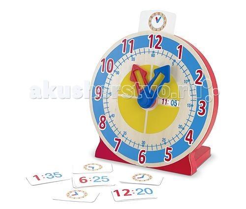 Деревянная игрушка Melissa &amp; Doug Первые навыки Часы с карточками-заданиями 2014Первые навыки Часы с карточками-заданиями 2014Деревянная игрушка Melissa & Doug Первые навыки Часы с карточками-заданиями 2014 - игрушка идеально подойдет для малышей, которые готовы обучаться времени.  У часов большие яркие стрелки и табло, которое показывает который час при помощи цифр. На подробном циферблате есть большие красные цифры, соответствующие часовой стрелке, маленькие голубые цифры, соответствующие показаниям минутной стрелки, диск разделён на 4 части, чтобы малыш понял выражения, четверть третьего, половина второго. Кроме того, в комплект включены карточки для тренировки. Вставьте карточку в держатель, затем предложите ребёнку поставить стрелки в нужное положение. Затем уберите карточку и сравните, если цифры совпадают, то всё получилось! На задней части часов есть специальное гнездо для аккуратного хранения карточек.<br>