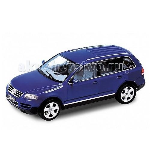Welly Модель машины 1:18 VW TouaregМодель машины 1:18 VW TouaregМодель машины 1:18 VW Touareg  Коллекционная модель машины масштаба 1:18 VW Touareg.   Функции: открываются передние двери, капот, багажник, поворотом руля поворачиваются передние колеса.<br>