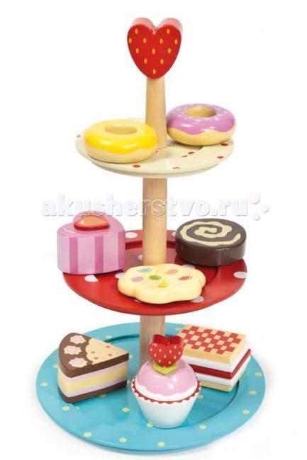 Деревянная игрушка LeToyVan Набор Этажерка с 8 пирожнымиНабор Этажерка с 8 пирожнымиLeToyVan Набор Этажерка с 8 пирожными.  Игрушечная еда Этажерка с пирожными производства английской компании Le Toy Van. Яркие игрушечные пирожные на этажерке могут пригодиться в нескольких сюжетных играх. Их можно взвешивать на игрушечных весах или считать.Эта этажерка вполне может стоять на прилавке игрушечного магазина или на кухне у домашней хозяйки.  Если кухня - это традиционно игрушка для девочки, то продавцом может быть и мальчик. Играя в магазин ребенок приобретает множество необходимых знаний и навыков необходимых ему в повседневной жизни: считать деньги и товары, взвешивать. Например, на ценнике за пирожные может стоять сумма за килограмм или за штуку.Все предметы сделаны из дерева. При производстве используются краски безопасные для детей.  Длина (см): 18 Ширина (см): 17.8 Высота (см): 29 Вес в упаковке (кг): 0,5 Объем (м3): 0.009<br>