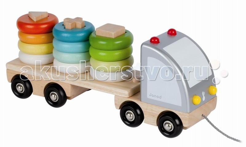 Каталка-игрушка Janod Грузовик с пирамидкойГрузовик с пирамидкойJanod Каталка Грузовик с пирамидкой.  Большая и длинная машинка-каталка Грузовик с пирамидкой, Janod. Машина состоит из двух частей: кузова и длинного прицепа. Грузовик перевозит другие игрушки - это пирамидка-сортер.В прицепе грузовика едут три пирамидки с деревянными колечками разных цветов. Колечки одеваются на палочки в форме геометрических элементов - квадрат, треугольник или крест.  Пирамидка также сортируется по трем основным цветам - красный, голубой, зеленый.Прицеп можно отсоединить от кузова.  Многоэлементная игрушка для ребенка 3 в 1 - игрушка, каталка, пирамидка-сортер: каталка-машинка - возим за собой грузовик с прицепом - просто играем цветная пирамидка - изучаем цвет, сортируем геометрическая пирамидка - изучаем фигуры, сортируем.<br>