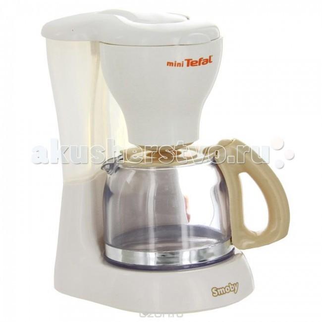 Smoby Кофеварка ТefalКофеварка ТefalКофеварка Smoby Тefal со шкалой уровня воды привлечет внимание вашей малышки и займет достойное место на детской кухне.   В кофеварку можно заливать воду, а после нажатия кнопки включения вода сама наливается в кофейник.   В комплекте с кофеваркой идет прозрачный кофейник с удобной ручкой. Теперь ваша юная хозяйка сможет приготовить вкусный кофе для своих игрушек.  Размер кофейника: 9 см x 5 см x 6,5 см. Размер кофеварки: 11 см x 13,5 см x 8 см.<br>