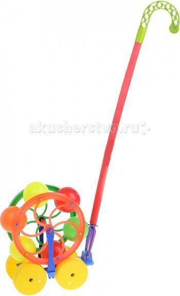 Каталка-игрушка Каролина-М Карусель 40-0033Карусель 40-0033Каталка Каролина-М Карусель - увлекательная детская игрушка, у которой есть эффект погремушки при качении.  Изделие состоит из трости и прикрепленной к ней конструкции на колесах. Когда малыш катит игрушку, она вращается и звенит.   Каталка может использоваться в качестве приспособления, помогающего крохе научиться ходить. А в дальнейшем с игрушкой просто весело гулять или бегать по квартире.<br>