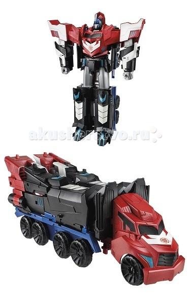 Transformers Hasbro Трансформеры Роботс-ин-Дисгайз Мега Оптимус ПраймHasbro Трансформеры Роботс-ин-Дисгайз Мега Оптимус ПраймMega Optimus Prime TRANSFORMERS Серия Роботы под прикрытием Robots in Disguise Hasbro b1564h.  Большой трансформер, легендарный Оптимус Прайм (Optimus Prime), высотой 22 см подарит много радости вашему ребенку.   Помимо большого размера и отменного качества, которым славятся игрушки Hasbro, робот легко трансформируется.  Отличительной чертой всех трансформеров серии Robots in Disguise является их трансформация в три шага.  Также просканировав значок автобота на его груди при помощи смартфона или планшета, можно открыть персонажа Оптимуса Прайма в мобильной игре Robots in Disguise.  Материал: высококачественный пластик. Размер игрушки: 22 см.<br>