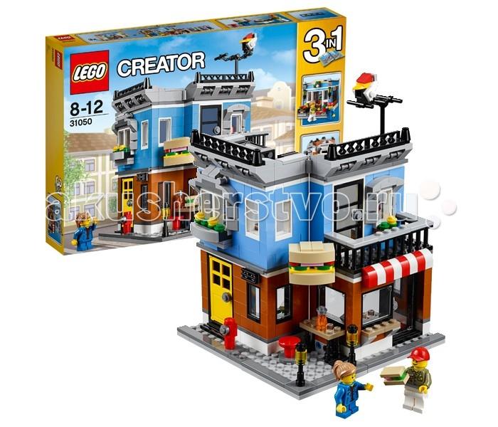 Конструктор Lego Creator 31050 Лего Криэйтор Магазинчик на углуCreator 31050 Лего Криэйтор Магазинчик на углуКонструктор Lego Creator 31050 Лего Криэйтор Магазинчик на углу   Магазинчик из набора Лего 31050 представляет собой двухэтажное здание, расположенное на углу улицы. Основой фундамента служит серый тротуар с пожарным гидрантом и декоративными фонариками. Фасад первого этажа выполнен из деталей коричневого цвета. При помощи уличного столика со стулом он разделён на две части. Слева видна ярко-жёлтая входная дверь, ведущая внутрь, а справа – уютная закусочная, предлагающая своим посетителям свежие сэндвичи. Для удобства обслуживания одно из прозрачных окон снабжено большой столешницей и поднимающимся стеклом. Это позволяет покупателям делать заказ «на вынос» и не тратить много времени на покупки.  Второй этаж здания, выкрашенный в голубой цвет, имеет несколько отличительных особенностей. Первой из них является наличие архитектурных элементов вокруг окон и крыши. Они эффектно контрастируют с лаконичными стенами и белыми рамами. К правой части фасада добавлен длинный балкон, на который можно выйти через стеклянную дверь. Он служит не только излюбленным местом отдыха обитателей дома, но и надёжной опорой для массивной вывески. Так как верхний уровень здания представляет собой жилое помещение, то заглянув внутрь комнат можно найти тумбу, диван и светильник. Для более реалистичной игры как снаружи, так и внутри дома, лучше использовать функцию трансформации. Перенеся вывеску и столик, Вы сможете полностью изменить пространство и превратить угловое здание в прямую часть улицы.  Размер дома в собранном виде составляет 20х17х14 см. При желании его можно переделать в таунхаус или цветочный магазин.  В наборе присутствуют 2 минифигурки и множество аксессуаров: пожарный гидрант, 2 фонаря, вывеска, сэндвичи, наружный блок кондиционера, стол, стулья, баночки со специями, кассовый аппарат, настольная лампа, телевизионная антенна, птица и цветы.  Количество деталей: 467 шт.<b
