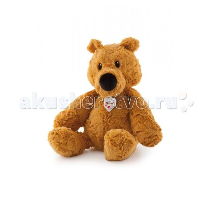 Мягкая игрушка Trudi Рыжий мишка 45 смРыжий мишка 45 смМягкая игрушка Trudi Рыжий мишка 45 см. Рыжий мягкий медвежонок с фирменным знаком на груди станет желанным подарком для ребенка или взрослого, ведь он сделан фирмой Trudi, которая делает игрушки кропотливо и аккуратно.  Игрушки от Trudi созданы с невероятной любовью, поэтому играть с ними — большое удовольствие! Вы можете брать мягкую игрушку на прогулку или в путешествие, потому что качественный материал, из которого сделан мишка, не меняется на солнце и пригоден для стирки. Вы можете выстирать медвежонка в машинке при температуре 30 градусов, игрушка не деформируется и станет совсем как новая!   Приятная на ощупь, плюшевая игрушка подарит много ласковых и позитивных минут. Игрушка безопасная для малышей, она создана из материалов, прошедших строгий контроль качества. Специальная набивка развивает мелкую моторику малышей. Trudi существует более 50 лет и дарит радость по всей Земле.  Размер: 45 см<br>