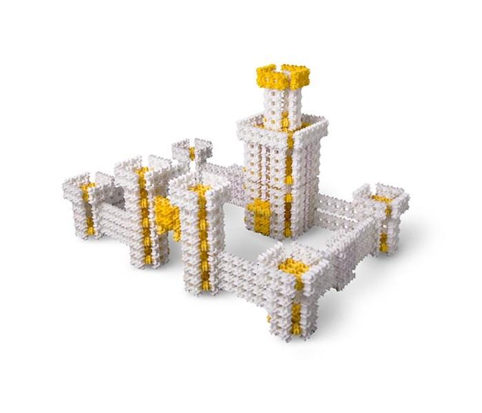 Конструктор Фанкластик Архитектика 308 деталейАрхитектика 308 деталейАрхитектор и строитель – самые главные профессии на планете ФАНКЛАСТИК.  Набор Архитектика предназначен для тех, кто хочет научиться собирать объемные архитектурные объекты практически любой формы или очертания: башни и небоскрёбы, космодромы и аэропорты, мосты, маяки и даже целые города.  В качестве первого архитектурно-строительного опыта предлагается собрать три модели:  Королевский замок Башня Космического маяка Небоскрёб Небесное Копьё высотой целых 164 сантиметра! Собранные модели обладают высокой прочностью, их можно переносить с места на место, надстраивать, усовершенствовать и использовать в качестве оригинального украшения домашнего интерьера. Фантазируя и экспериментируя, ребенок легко превратит Королевский замок в здание современного аэропорта, а Небоскрёб – в космическую ракету. Проявив фантазию, можно собрать здание по собственной схеме.  Набор Архитектика в дополнение к основным 3 тематическим моделям позволяет собрать дополнительные 11 моделей из других наборов в цветах собственных деталей. Это значительно расширяет его творческое и игровое применение.  Размеры моделей: Королевский замок- 38 х 11 х 6 см Башня Космического маяка - 29 х 80 х 18 см Небоскрёб- 24 х 164 х 24 см<br>