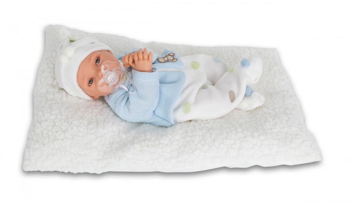 Munecas Antonio Juan  Кукла Ману озвученная 29 смКукла Ману озвученная 29 смКукла-младенец Ману выглядит совсем как ребенок. Она одета в костюмчик с шапочкой, дополнена одеяльцем.  Личико сделано с детальными прорисовками. Образы малышей Мунекас разработаны известными европейскими дизайнерами. Они натуралистичны, анатомически точны, с подвижными ручками и ножками, копируют настоящих младенцев.  Малыш умеет разговаривать: нажмите на животик 1 раз - кукла засмеется, 2-ой раз - кукла скажет мама, 3-ий раз - скажет папа.   Кукла с виниловыми подвижными ручками, ножками и головой, и мягконабивным туловищем.   Кукла упакована в красивую подарочную коробку.  Куклы Antonio Juan Munecas существуют уже более 40 лет и пользуется заслуженной популярностью в Европе. Куклы производятся исключительно в Испании, из высококачественных материалов, безвредных для ребенка. Образы кукол разрабатываются ведущими Европейскими дизайнерами, они высокохудожественны, натуралистичны (девочки/мальчики), одеты в красивую современную одежду, сшитую из натуральных тканей. Упакованы в стильные фирменные коробки.  В наш век технического прогресса классические куклы Антонио Хуан, с милыми добрыми детскими чертами не перестают пользоваться популярностью, а способность разговаривать, смеяться и плакать делает их вполне современными и интересными даже для самых «продвинутых» деток.<br>
